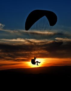 Go paragliding.. preferably at sunset cause this looks beautiful #bucketlist