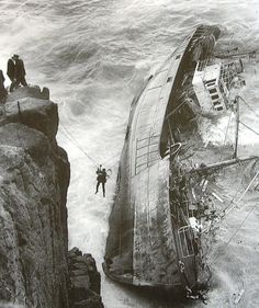 +~+~ Vintage Photograph ~+~+ Crew member is rescued from the French fishing trawler Jeanne Gougy which ran aground at Lands End, Cornwall. 12 men, including the Skipper lost their lives. Abandoned Ships, Abandoned Places, Vintage Photographs, Vintage Photos, Ghost Ship, Shipwreck, Tall Ships, Historical Photos, Belle Photo