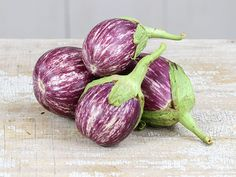 "Listada de Gandia is one of the most popular heirloom eggplants; this one has 7""-long fruit that are white with lovely bright purple stripes."