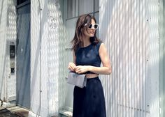 Skirt and top by Calvin Klein Collection, shades by Acne and bag by Stella McCartney.