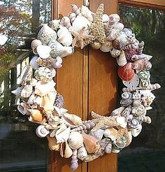 Great idea for a summer wreath! Finally figured out what to do with all those shells the kids collect at the beach.
