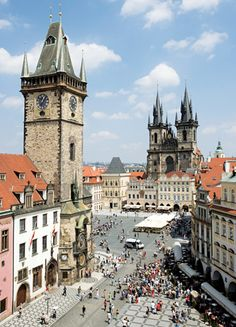 OLD TOWN SQUARE. PRAGUE, BOHEMIA, CZECH REPUBLIC. The hub of Prague's energetic street life, the Old Town Square overflows with outdoor cafés, musicians, and squadrons of tourists gawking at such sights as the Orloj, the 600-year-old astronomical clock. Nearby, the twin-spired, 14th-century Church of Our Lady Before Tyn offers one of Prague's most recognizable silhouettes.