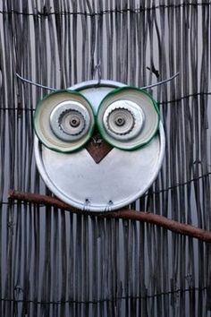 Garden owl from jar lids, bottle caps and a pie plate