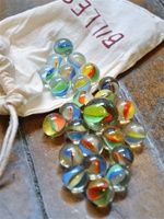 marbles-I loved playing marbles, used my heel to make the divot in the dirt!!
