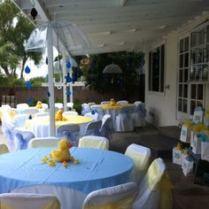 """My baby shower for baby Andrew... Took the """"shower"""" part literally and hung clear umbrellas with rain drop cutouts connected with yarn. We used simple ducky dolls and bath toys as center pieces."""