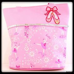 Your little ballerina will want to take her favorite ballet stuff, snacks, phone and fun little toys with her in this adorable ballet handbag! The ballet shoes applique is embroidered and has opaque sequins that sparkle. A line of silver sequins adorn the front side of the bag.
