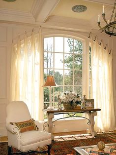 "Large windows don't always need large treatments. And by ""large"", we mean complicated--those with many yards of fabric, layers of trim, and a hefty price tag. Especially when the window has strong architectural details, less is more."
