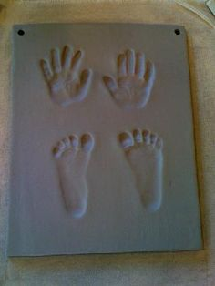Clay slab with child's hand and feet prints in it. Keep sake. (I can so do this).