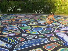 The annual painting of the Mandala. Roberts Creek, Sunshine Coast, BC. The whoel community gets involved. my grandsons were 3 and 5 years old when they first painted their little piece of ground.
