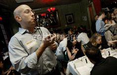 NEW YORK - MAY 28, 2003:     Ken Deckinger, a co-founder of HurryDate, blows a whistle to let everyone know its time to alternate dates during a speed dating event May 28, 2003 in New York City. Speed dating is a trend in New York, pitting dozens of singles together for dozens of short 'dates' in an evening. Participants fill out cards if they're interested, and event organizers e-mail any resulting matches. (Photo by Chris Hondros/Getty Images)
