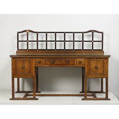 Sideboard - Material: walnut and mother of pearl Style: Arts and Crafts (movement) Designer: Heal, Ambrose (Sir) - Maker: Jones, William Place: England - Exposition des Arts Decoratifs de Grande Bretagne Collection