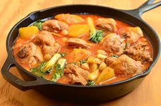 chicken pochero is a Filipino stew made with chicken simmered in tomatoes with garbanzo beans, chorizo bilbao, saba bananas, potatoes and pechay
