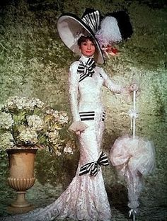 Vintage look for Ascot.The costume designed for Eliza Doolittle, designed by Cecil Beaton (My Fair Lady 1964)is a reflection of high society fashion in the early 1900s of Edwardian England. Her dress was worn when she attended the famous Ascot Racecourse (horse races). It embodies the qualities of upper-class society with long and elegant lines and a slight release of the corset and bodice.