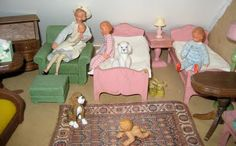 Vintage Caco dolls in the dollhouse nursery