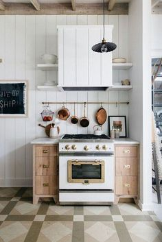 There are a ton of different ways to bring shiplap wall paneling into your kitchen design, whether you want a neutral paneled look or one with heaps of trendy color. #hunkerhome #shiplap #shiplapideas #kitchenshiplap