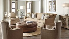 The Huntington House 3187-20 sofa is curved ever so slightly, bringing loved ones closer together! Shown with a pair of 7451-50 chairs, 3355-56 swivel chair and the lovely 2021C-55/54 round leather tufted ottoman. #furniture #interiordesign #livingroom