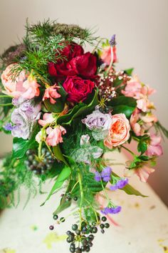 Roses, greenery, berries, and wispy ferns | Photo by Okrfoto | Floral design by Asrai Garden