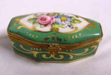 Limoges Box...my parents have given me one for birthday and Christmas since I was 13.   Love these so much