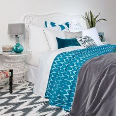 Amazing bedroom with bed linen in blue, silver and white