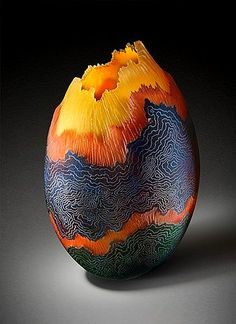 I'm really not sure what this is, but it looks like an egg made of lava!  Work by Robert Coby