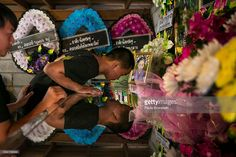 The brother of Chomphu, age 8, peers into her coffin during a memorial service in the Hmong community of Jom Thong, Chiang Mai province May 25, 2016. A tragic fire broke out on Sunday night killing at least 17 girls at the Pitakkiat Wittaya school, home to pupils from impoverished local hill tribes in the region, they were aged between 5 to 13. Based on reports, many of the 38 students were asleep when the fire swept through the elementary school in Chiang Rai Province and investigations…