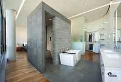 open-concept-master-bedroom-and-bath-Bathroom-Modern-with-blocky-closet-column-curved
