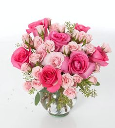 A fresh vase arrangement with soft and bold pink Roses and Spray Roses.  Love it? We ship nationwide! @nanzkraft
