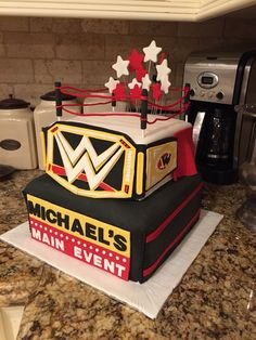 WWE Wrestling Cake for a 40th birthday. Bottom layer is Vanilla Cake with Strawberry Jam and buttercream. Top layer is Red Velvet.