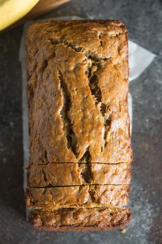 An overhead view of a loaf of Skinny Banana Bread. This Skinny Banana Bread is so incredibly moist, perfectly sweet, and delicious -- you would never know it's Healthy Bread Recipes, Banana Bread Recipes, Healthy Sweets, Ww Recipes, Healthy Baking, Dessert Recipes, Cooking Recipes, Family Recipes, Cake