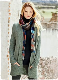 The plaid scarf is woven in bright, contemporary hues in a soft wool blend.