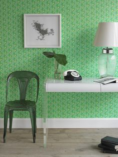 From Wall Collective @WallpaperNYC | The white and dark green accessories just pop off the cheery spring green wall covering