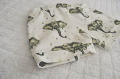 ** PRE-ORDER ONLY -- will take up to 4 weeks to be shipped**this elephant print short is uniquely designed exclusively for Our Little Lullaby, and made with the softest fabric for your little one's delicate and sensitive skin.these shorts are 100% USA grown GOTS certified organic cotton, the highest quality organic material with no harmful chemicals. we offer a high quality braided elastic waistband to stretch with your growing little ones.please note that all your short...