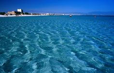 Shallow waters of Poetto Beach, Cagliari, Italy