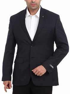 A must-have jacket for an authentic refined look, this Raymond Blue Line Men Blue Formal Jacket is designed for the sharp-dressed man. Impressive in a dark blue color, it also features mild checks that add a sophisticated touch. Made of poly viscose, the fabric is soft and smooth to provide the utmost comfort for wearing. Granting a modern fit, it also looks trendy. Complete the outfit by pairing this with a white shirt and cotton trousers along with a pair of formal shoes.