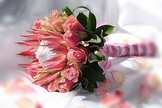 Protea and rose wedding bouquet.The King protea is the national flower of South Africa Protea Wedding, Rose Wedding Bouquet, Floral Wedding, Ethnic Wedding, Protea Bouquet, Pink Bouquet, Protea Flower, Wedding Flower Photos, Wedding Flowers
