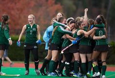 The Ohio University field hockey team celebrates senior JESSICA JUE's game winning goal in double overtime at the Bobcats' last game of the season. Ohio clinched the victory against Kent State University 3-2 in double overtime on Saturday, November 2, 2013. (ISAAC HALE | STAFF PHOTOGRAPHER)