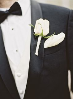 Winter groom in classic black tux + ivory rose boutonniere and pocket square {Jordan Brian Photography}