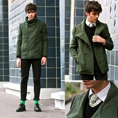 Consider teaming a dark green pea coat with black chinos if you're going for a neat, stylish look. Black leather derby shoes will add elegance to an otherwise simple look. Shop this look on Lookastic: https://lookastic.com/men/looks/pea-coat-waistcoat-dress-shirt-chinos-derby-shoes-tie-socks/1230 — White Dress Shirt — White Polka Dot Tie — Black Wool Waistcoat — Dark Green Pea Coat — Black Chinos — Green Socks — Black Leather Derby Shoes