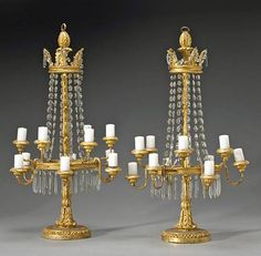A pair of George III giltwood and cut glass twelve light girandoles, late 18th century