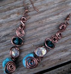 """Hand-Formed Artwear Earrings.    Materials: Real Turquiose & Swarovski Crystals """"Entwined"""" with Copper."""