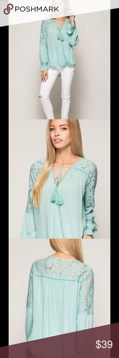 Surplice blouse Long flare sleeve surplice blouse with lace trim and tassel ties. Composition :70% cotton, 30% polyester. Tops Blouses