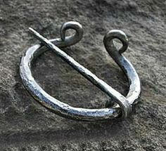 """Smooth Iron Penannular by Brooches, Penannulars and Kilt Pins. $47.00. Excellent for Renaissance, Elizabethan, Medieval or Cavalier Festival. Smooth Forged Iron Penannular Size: 3"""" Diameter (varies slightly- each hand made). See our full line of patterns and cloak clasps at www.patternsoftime.com. Great finishing touch for Renaissance, Medieval, Cavalier, Regency, Elizabethan, Colonial, Georgian, English Civil War, American Revolutionary War Cloaks, Capes, Coats o..."""