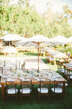 #Outdoor Wedding with Market Table Umbrellas | See the wedding on SMP | http://www.StyleMePretty.com/2014/01/10/malibu-wedding-at-rancho-del-cielo/ Laura Goldenberger