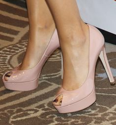 This former black swan shows her softer side with a pair of sweet, pink peep-toes designed by this top Italian line.Who's pretty in pink in these peep-toes? | Who's the designer?
