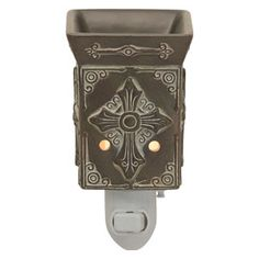 CHARITY SCENTSY NIGHTLIGHT WARMER Understated and inspired, Charity's matte antique white finish over slate-like shades of brown, rust, and green highlights embossed Spanish-style details.…