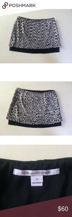 """Dvf mini skirt gray black sequins white 6 Elley This is a mini skirt by Diane von Furstenberg called Elley. It is embellished with gorgeous gray scale sequins and has a contrasting solid black lining that peeks out at the hem. It is a size 6. Size zipper closure. Shell is 100% polyester, lining is 97% polyester, 3% spandex. Dry clean.  Waist: 15.5""""-16"""" Hips: 18.5""""-20"""" Length: 14"""" Diane von Furstenberg Skirts Mini"""