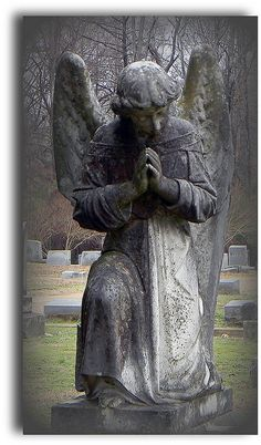 The statue or tomb stone Hamlet and Horatio duck behind to hide and spy on the funeral. It also pertains to the fallen angel comparison with Ophelia. The angel also keeps the mourning mood with the bowed head and kneeling.