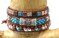 Southwestern Beaded Leather Wrap Bracelet-Boho Leather Wrap-Silver, Turquoise, Dark Copper, and Bright Copper Leather by CinfulBeadCreations on Etsy Hippie Bracelets, Beaded Bracelets, Wrap Bracelets, Beaded Jewelry, How To Make Leather, Beaded Leather Wraps, Semi Precious Beads, Beads And Wire, How To Make Beads