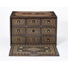 Cabinet Gujarat (probably, made)  Sindh (possibly, made)  Date: 16th century (made)  Artist/Maker: Unknown  Materials and Techniques: Wood, veneered with rosewood, inlaid with exotic woods, ivory, brass and micromosaic motifs