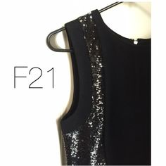 New Black Sequin Dress ️Stunning Dress by F21. Black dress with black sequins along both sides from top to bottom. Has underskirt. Hugs the body like a Bodycon but not as tight. Zipper and clasp in back. Round neck. New without tags. Never used. Selling for now. 35 in long. Fits a small. Forever 21 Dresses